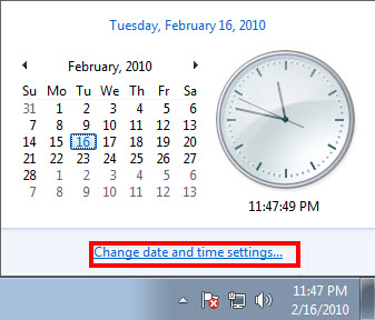 The clock window with the Change date and time link highlighted in Windows 7.